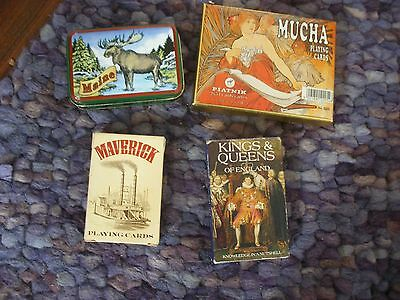 3 sets of playing cards , bridge, and magic cards