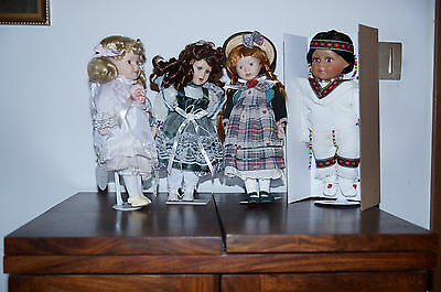 Four porcelain dolls from Leonardo Collection: all 13'' tall