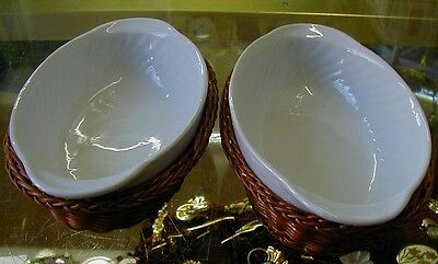 4 x porcelain serving dishes in wicker baskets.