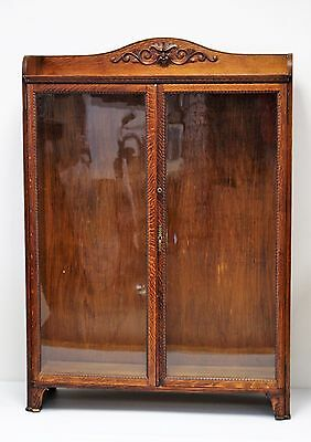 Circa 1900 TIGER OAK 2-DOOR BOOKCASE WITH CARVED NORTHWIND GOD CREST