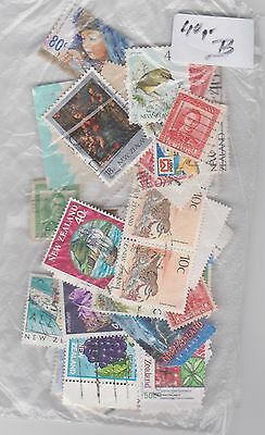 40 grams New Zealand stamps off paper (approx 150+ stamps) B