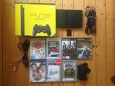 Sony PS2 Slim (Black) console + 7 games