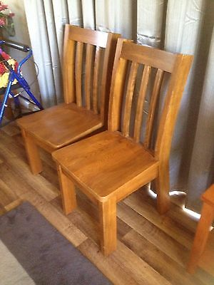solid wood dining chairs x 2 Noosaville