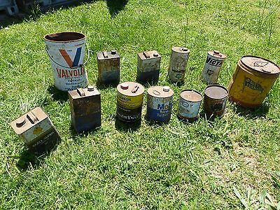 Various old motoring/oil/fuel cans