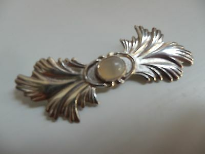 Sterling silver brooch with white opal cabochon