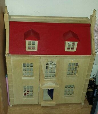 Wooden dolls house with characters and furniture