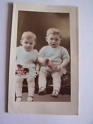 Vintage Tinted Photo Two Children Sitting Holding Flowers