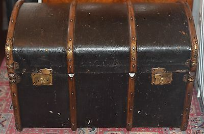 A vintage canvas and wooden ribbed dome top travel trunk