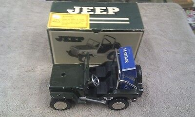 Vintage Boxed Jeep Willys Lighter and cigarette packet holder.