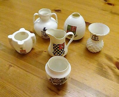 Six pieces of W.H. Goss Crested China