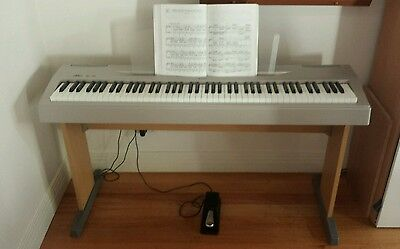 Yamaha P-60 digital piano with stand and sustain pedal