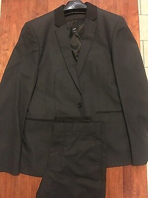 yd Black Suit (jacket, slacks, tie, vest... all black)