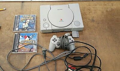 ps 1 console with 1 controller with wires and two games