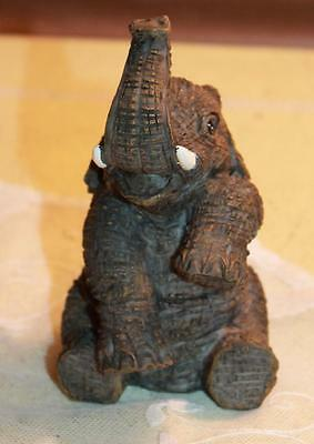 Youngs China Sitting Resin Elephant with Raised Trunk Figurine 4""