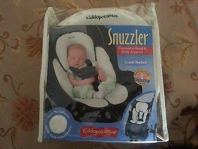 The Snuzzler is ideal support for baby's  back and head.