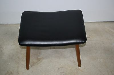 Danish mid century footstool with wooden legs, upholstered in imitated leather