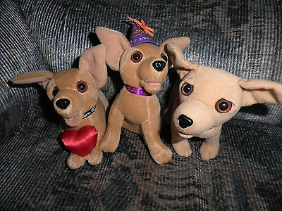 Taco Bell 3 Plush Dogs - They Talk - Themes are New Year , Heart, and Yo Quiero