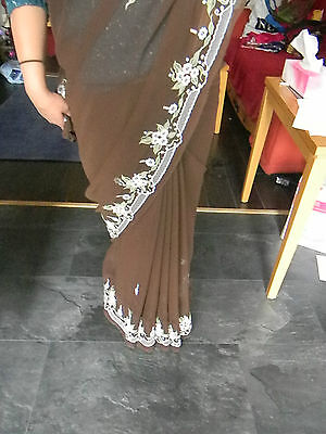 Brown saree with floaral emboidary.