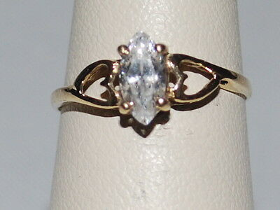 10K Gold ring with a marquise shaped diamond