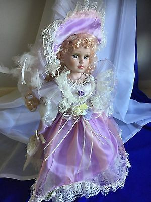 Collectible Porcelain Doll in Light Purple Gown