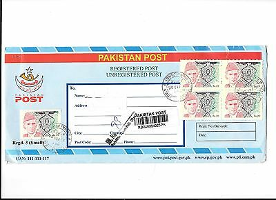 Pakistan post Registered Post envelope carrying 12 x 20 Rupee stamps fine used.