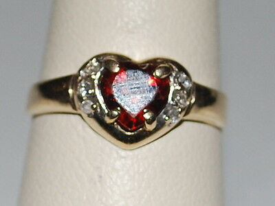 10K Gold ring with heart shaped red gemstone and diamonds
