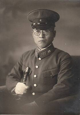 Original WWII Photo JAPANESE SOLDIER holding SWORD & Wearing GLASSES 1940's