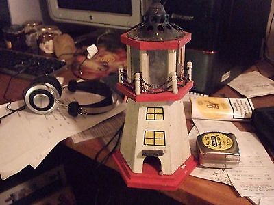 Wooden painted model Lighthouse illuminated by tea light in the top.