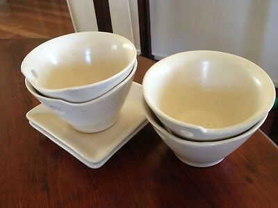 Four Cream Ceramic Rice Bowls  And Two Serving Plates
