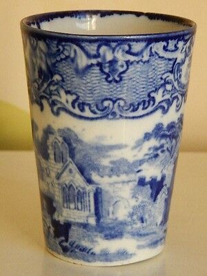 Antque blue and white pottery beaker decorated with classical ruins