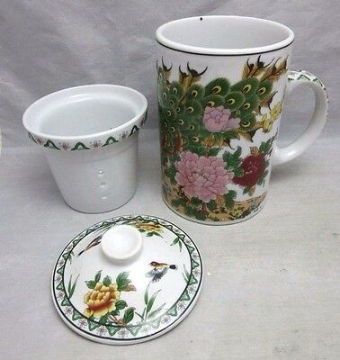Tea mug with infuser and cover. Asian peacock design