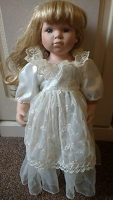 Large Porcelain doll  19 inches high unbranded on stand with lovely dress