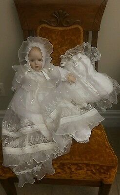 Christening doll porcelain doll with pillow and gold bracelet