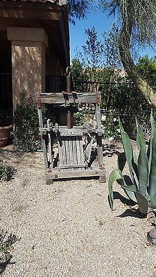 antique wooden press, may be a wine or grape press