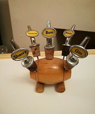 Vintage  Sherry Gin Brandy Vermouth rum Bottle Stopper Pourers in wooden barrel