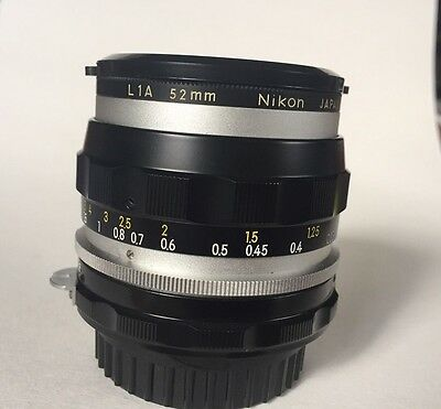 Vintage Nikon Nikkor-S Auto 35 mm 2.8 lens with caps and shade