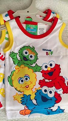 SESAME STREET 000 BABY PACK OF TWO SINGLETS, BRAND NEW ON HANGER, ABC and Crew