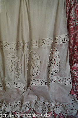 An antique French Art Nouveau needle lace curtain