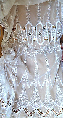 A pair of antique French embroidered lace tulle curtains
