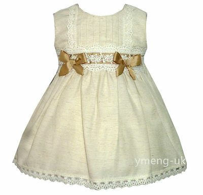 Beautiful Baby Girl's Spanish Cream Dress with Lacey Details/Romany/Tan Bow
