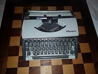 VINTAGE OLYMPIA Deluxe Manual Portable Typewriter and Case West Germany