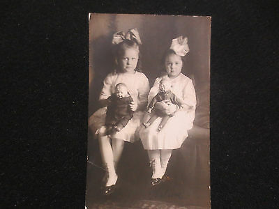 PHOTOGRAPH OF TWO LITTLE GIRLS WITH THEIR PRECIOUS DOLLS,RPPC c1910 DOLLS