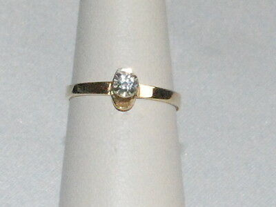 14k Gold ring with Solitaire Diamond
