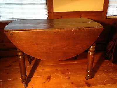 Antique walnut drop leaf table and three oak chairs