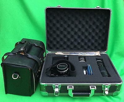 Canon FT QL 35mm Film SLR Camera with 3 lenses,  2 case, and lots accessories