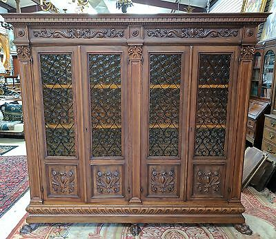 Antique Italian Walnut Renaissance 4 Door Bookcase with Iron Grill & Amber Glass