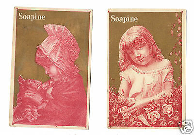 Two Soapine Red-Toned Trade Cards Girls with Gilded Background, Flowers, Cat