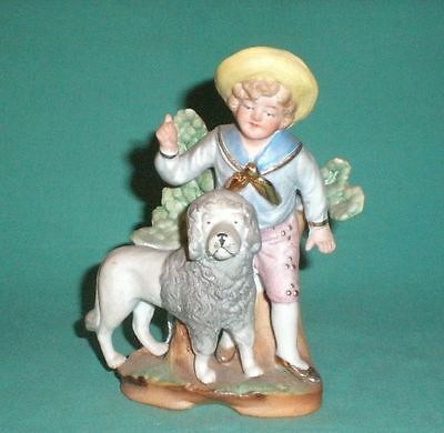 antique bisque figurine, boy with poodle/Fasold & Stauch/1910s/Germany