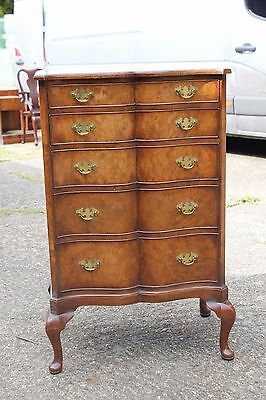 A Walnut Serpentine chest of drawers