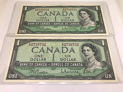 Two 1954 Consecutive Uncirculated One Dollar Bills